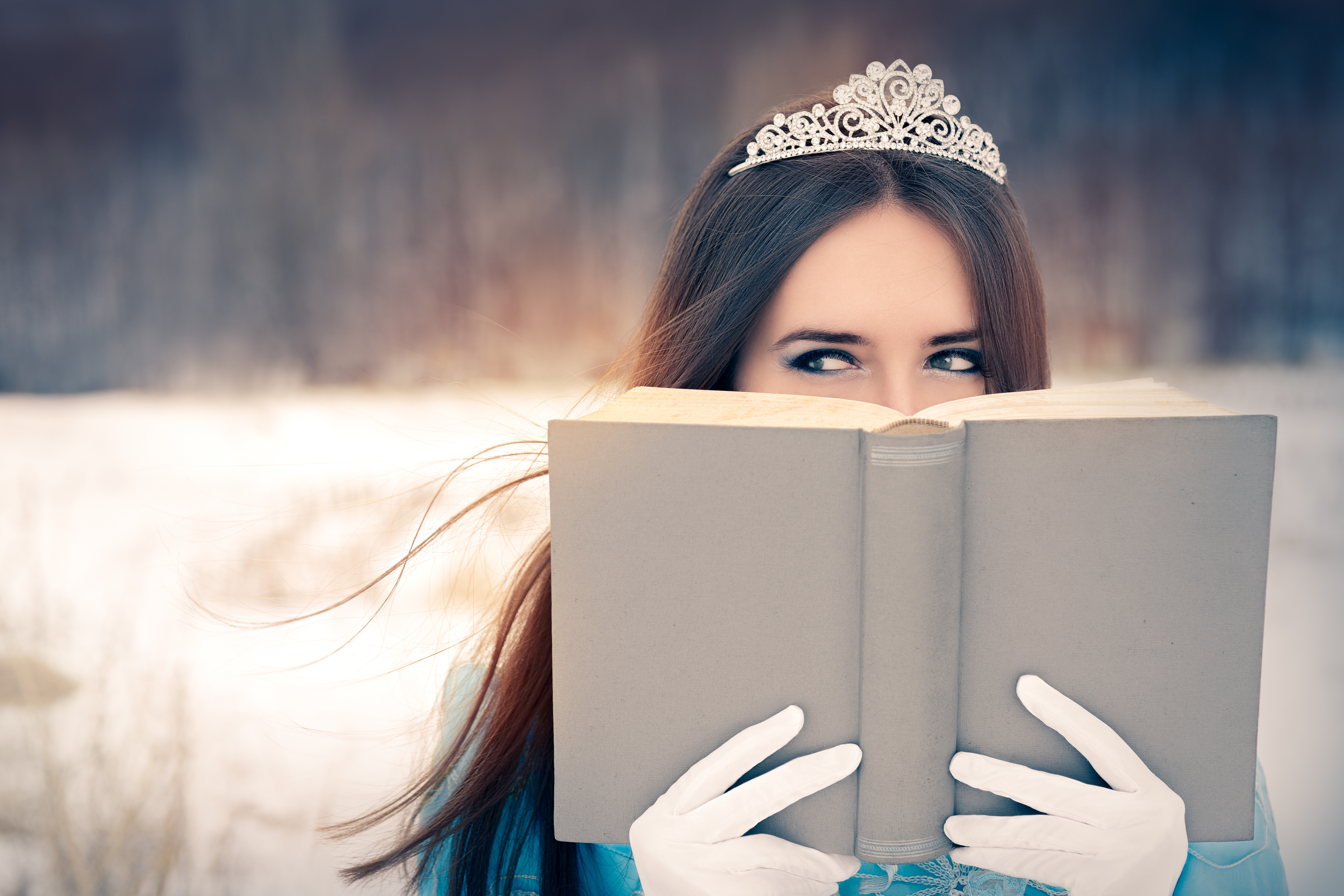 49632503 - beautiful snow queen reading a book